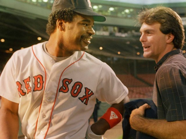 Boston Red Sox outfielder Dave Henderson, left, jokes with quarterback Doug Flutie prior to the start of Game Six of the American League Championship series against the California Angels in Boston, Oct. 14, 1986. The Chicago Bears have acquired the rights to Flutie from the Los Angeles Rams for an unannounced future draft choice, Bears' general manager Jerry Vainisi announced Tuesday. (AP Photo/Peter Southwick)